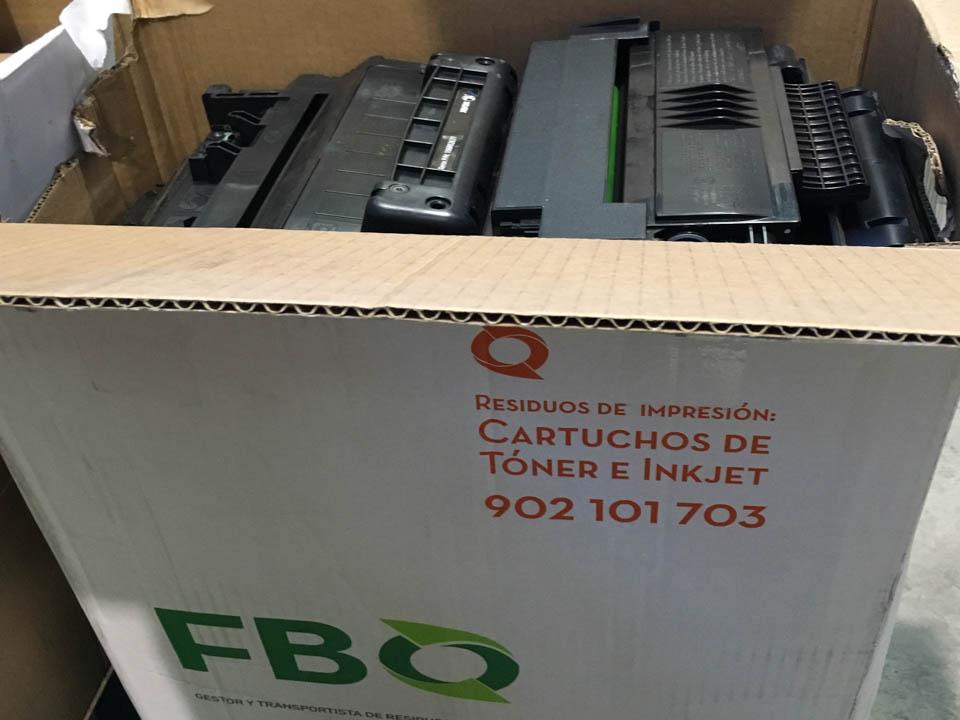 Ecobox Fbo Organisation con cartuchos de tóner vacíos.